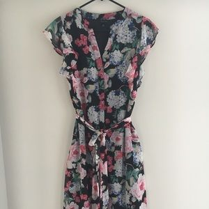Cocktail floral dress with wrap.